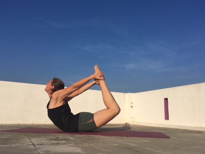 yoga ashok tree dhanurasana bow pose retreat yogini arunachala